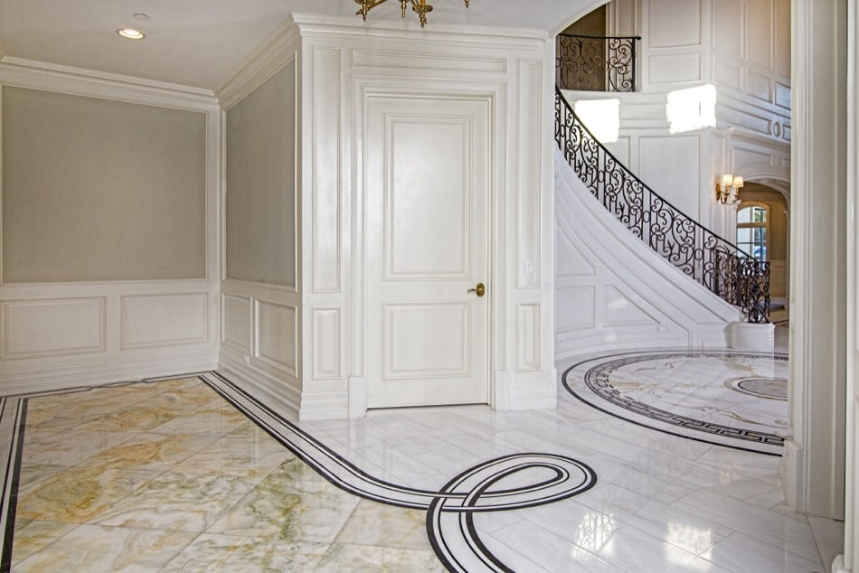 Loop design marble floor and wrought iron staircase view built by Richard Smith Custom Home Development