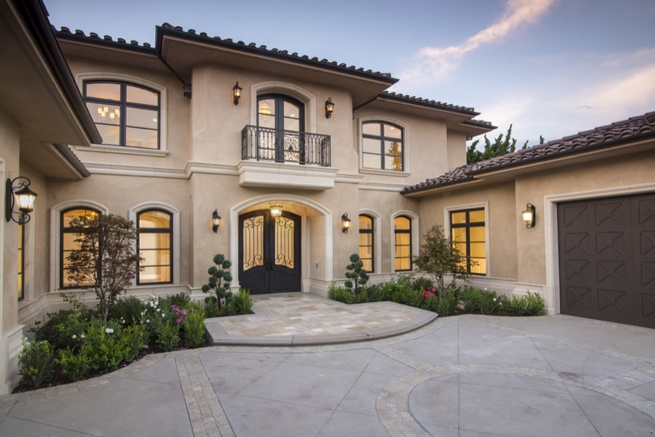 Front view of Mediterranean style Arcadia mansion with balcony built by Richard Smith Custom Home Development